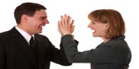 "Image of a Manager giving a high five and letting one of her key people know ""You're the Person I Want to Keep"""