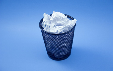 Image of a trash can full of traditional job descriptions that are worthless for hiring effectiveness